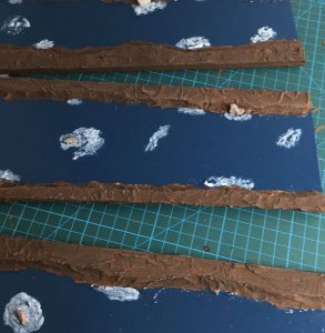 Painting the currents to give the modular river for wargaming more fluff