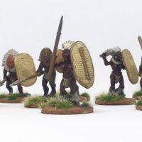 Darkest Africa Tribal Warriors in hideous masks